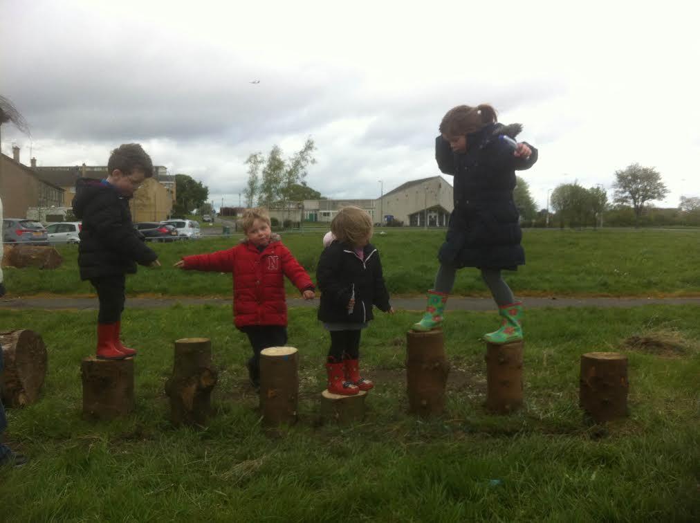 kids on logs