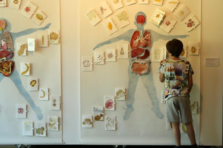 Seth looking at big paintings