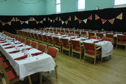 three tables and bunting